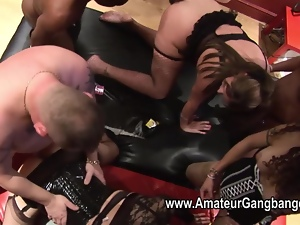 Two shemales join in at an amateur gangbang orgy