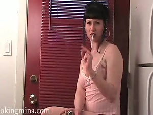 Mina smokes cigarette in sexy lingerie