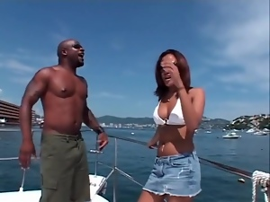Bikini babe sucks black cock on a boat