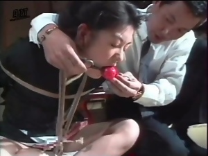 Gagged and bound girl drools in BDSM video