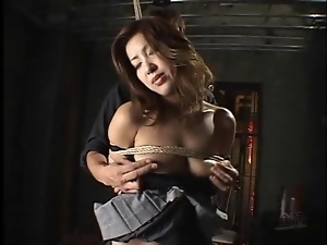 Tied up Japanese girl fingered in her cunt