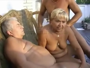 Grandpas and granny fool around outdoors