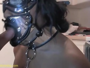 Black girl in kinky BDSM mask sucks dick