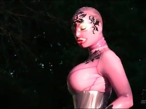 Corset and rubber catsuit on big tits babe