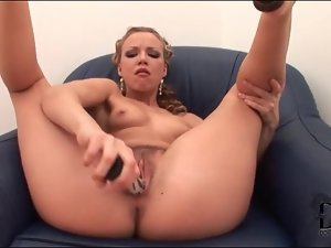 Glamorous blonde girl fucks pussy with dildo