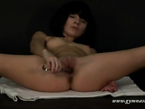 Beautiful ballerina bends and masturbates