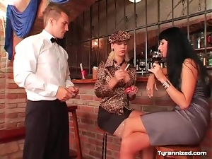 Smoking girls dominate the waiter at the bar