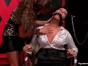 Drool drips from the mouth of gagged girl