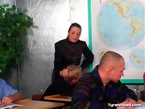 Mistress and her submissive male students