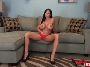 Solo brunette with big fake tits gets naked