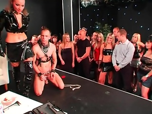 Femdom stage show features trampling of guy