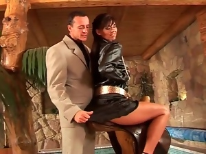 Arousing girl in satin outfit teases the guy