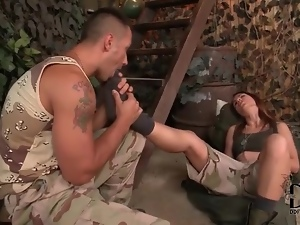 Soldier fondles the feet of a cute girl