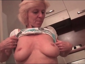 Granny has sexy implants to model for us