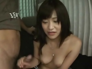 Shy girl gives a handjob in the van