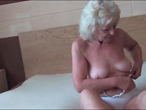 Granny lubes and fingers her sexy pussy