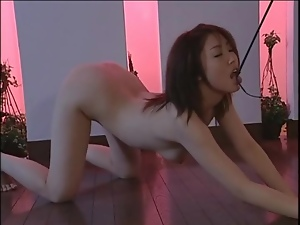 Mistress in latex dominates Japanese girl
