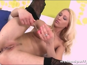 Slut in fishnets fools around with toys