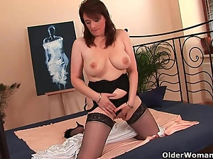Busty older woman unloads a cock in her face