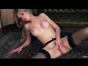 Stockings and garter belt on masturbating babe