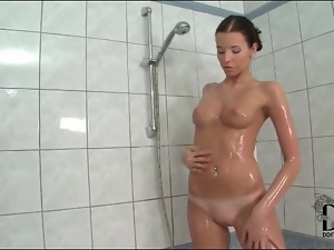 Angel Hott rubs her perky tits in the shower