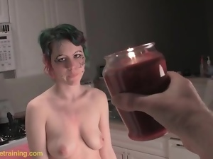 Hot wax on slender naked body of punk slut