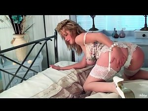 Big breasted Louise Emerson in white lingerie