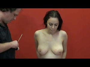 Bamboo sticks pinch her nipples tight