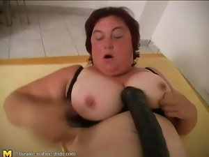 Fatty fucks her vagina with her huge dildo
