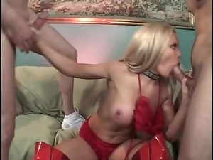 Bimbo cocksucker in shiny red latex boots