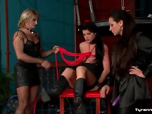Sissy and mistress put sexy girl in bondage