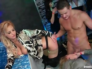Chick on stage fucked from behind at party