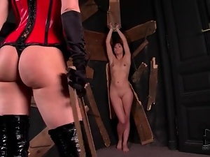 Slim tied up girl suffers pain from mistress