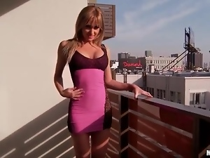 Girl with gorgeous body models skintight dress