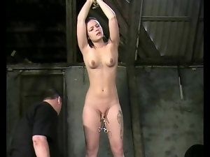 Bound girl in his dungeon takes pussy torture