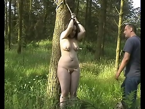 Fat girl tied in the woods likes great pain