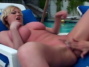 Busty blondes feast on each other outdoors