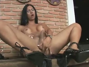 Sexy brunette babe with big cock jerking in solo