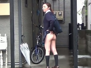 Japanese schoolgirl flashes outdoors and jerks off