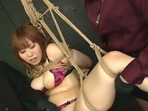 Suspended asian slave takes toys in her hairy cunt