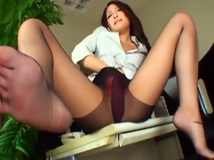 Japanese office girl in pantyhose gives a footjob