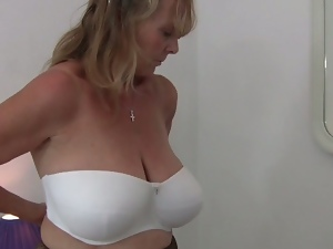 Horny grandma tries on clothes and masturbates