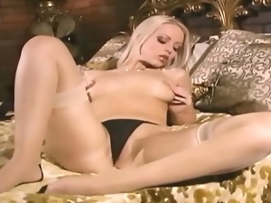 Classy blonde offers an artistic strip show