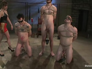 Three tied up and blindfolded get humiliated by a mistress