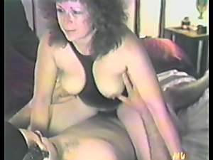 Mature woman sucks a dick and gets toyed in retro video