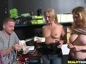 Two Gorgeous Girls Are Fucked By a Dude Upon a Desk