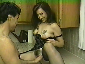 Brunette with ugly tits blows and gets fucked in the kitchen