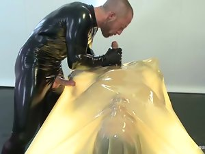 Latex poofter Adam Herst plays with Alex Adams's ass and cock