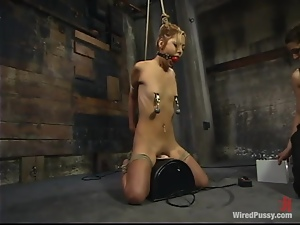 Skinny Kat gets humiliated and electrified in bondage video