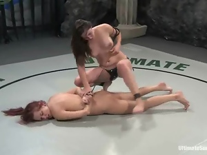 Redhead lesbian gets fucked by her rival after a fight on tatami